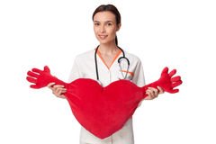 Medicine student holding a big heart Royalty Free Stock Image