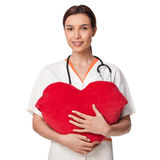 Medicine student holding a big heart, smiling Stock Photography