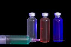Medicine and syringe Stock Images