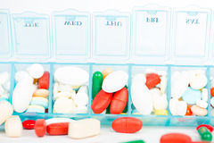 Medicine tablet and capsule in weekly pill box Royalty Free Stock Photos