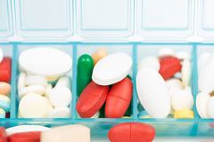 Medicine tablet and capsule in weekly pill box Royalty Free Stock Image