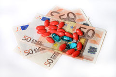 Medicine, tablet, money. Pills blisters of pharmacy to cure pain and illness Stock Photography
