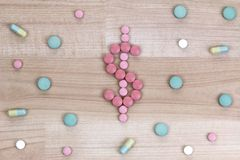 Medicine tablets in a shape of Dollar Sign Royalty Free Stock Images