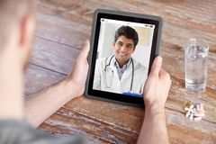 Patient having video chat with doctor on tablet pc royalty free stock image