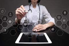 Medicine technology and healthcare concept. Medical doctor working with modern pc. Icons on virtual screen.