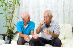 Medicine treatment. Asian senior men having medicine at home. Adult son caring for a senior man Royalty Free Stock Photo