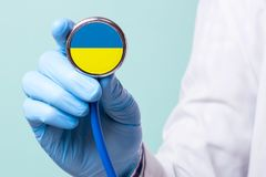 Medicine in Ukraine is free and paid. Expensive medical insurance. Treatment of disease at highest level Doctor  stethoscope. Medicine in Ukraine is free and Royalty Free Stock Images