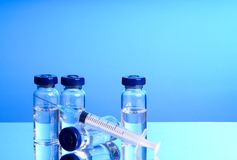 Medicine in vials and syringe Stock Photos