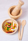 Medicine and vitamin on wooden bowl Royalty Free Stock Images