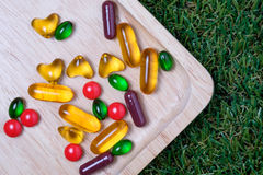 Medicine and vitamin on wooden plate Stock Photo