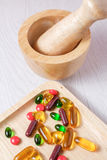 Medicine and vitamin on wooden plate Royalty Free Stock Photos
