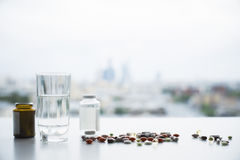 Medicine and water glass Stock Photos
