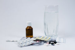 Medicine and water in a glass Royalty Free Stock Photography