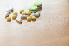 Medicine on wooden table Stock Photo