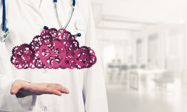 Medicine worker presenting in her palms cloud computing concept Royalty Free Stock Photos