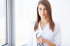 Medicine. Young female doctor in modern clinic stock images
