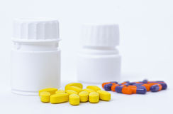 Medicines. Pill bottles with medicine out. white background stock images