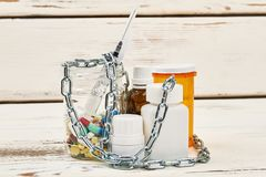 Medicines banned by sport comitee. Medicines banned by sport committee. Chains over bottles with pills. Anti-doping list Stock Photography