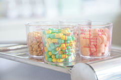 Medicines in beaker with background Royalty Free Stock Image