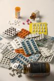 Medicines in bottles and packets. Bottles and packets of pills on a white background Royalty Free Stock Images