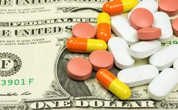 Medicines, capsules and pills lying on bills Stock Photos