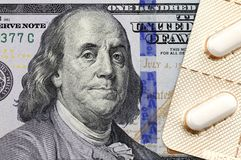 Medicines on the dollar. One hundred dollars and medicines Stock Photography