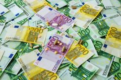 Medicines and the euro. Different types of medicines with a banknote background, many types of medicines lie on euro banknotes Royalty Free Stock Photo