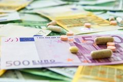 Medicines and the euro. Different types of medicines with a banknote background, many types of medicines lie on euro banknotes Stock Images