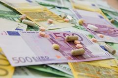 Medicines and the euro. Different types of medicines with a banknote background, many types of medicines lie on euro banknotes Stock Photography