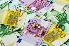 Medicines and the euro. Different types of medicines with a banknote background, many types of medicines lie on euro banknotes Stock Image