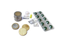 Medicines and euro money coins isolated on white Stock Image