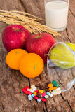 Medicines and fruits Stock Image