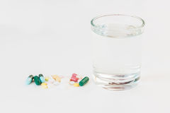 Medicines with glass Royalty Free Stock Images