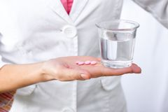 Medicines in hand close-up Stock Photography