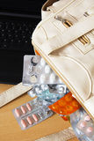 Medicines in Handbag. Medicines, Tablets, Capsules and Empty Blister in Women Handbag Royalty Free Stock Photo