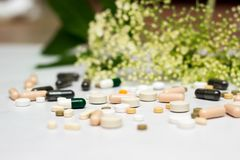 Medicines and herb. Large group of pills with herb concept stock photo