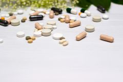 Medicines and herb. Large group of pills with herb concept royalty free stock photos