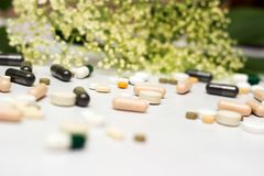 Medicines and herb. Large group of pills with herb concept stock images