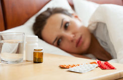Medicines for ill woman. Horizontal view of medicines for ill woman Stock Photos