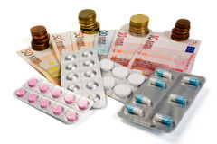 Medicines and money. Medicines on paper money and euro coins Stock Images