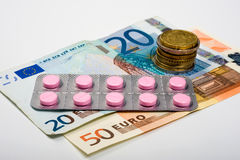Medicines and money Royalty Free Stock Photos