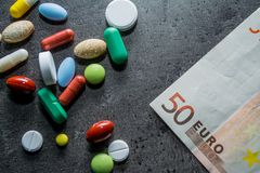 Medicines and money. Expensive medicine. Heart. Medicines on a black background Stock Photo