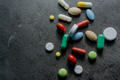 Medicines and money. Expensive medicine. Heart. Medicines on a black background Stock Photography