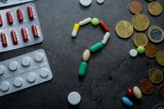 Medicines and money. Expensive medicine. Heart. Medicines on a black background Royalty Free Stock Images