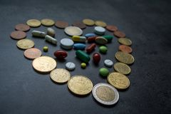 Medicines and money. Expensive medicine. Heart. Medicines on a black background Royalty Free Stock Photography