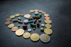 Medicines and money. Expensive medicine. Heart Stock Photography