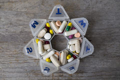 Medicines daily set in a pillbox Stock Image