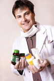 Medicines and supplements. Doctor holding a variety of medicines and supplements Stock Photos
