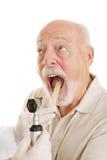 medicinsk ahhh säger pensionären Arkivbilder