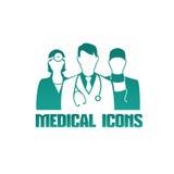 Medicinsk symbol med olika doktorer Arkivfoto